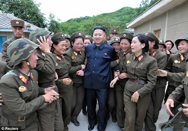 With the ladies: North Korean dictator Kim Jong Un with female members of the Korean People's Army Unit 4302 in an undated picture. Many of the artillery units along the coasts are manned with women
