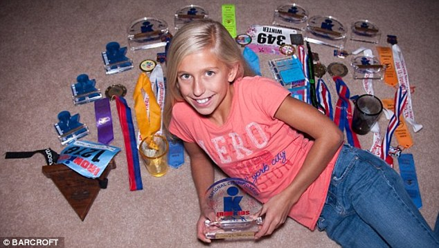 Record breaker: Winter Vinecki at 11, with her haul of medals won in the two years after her father's death