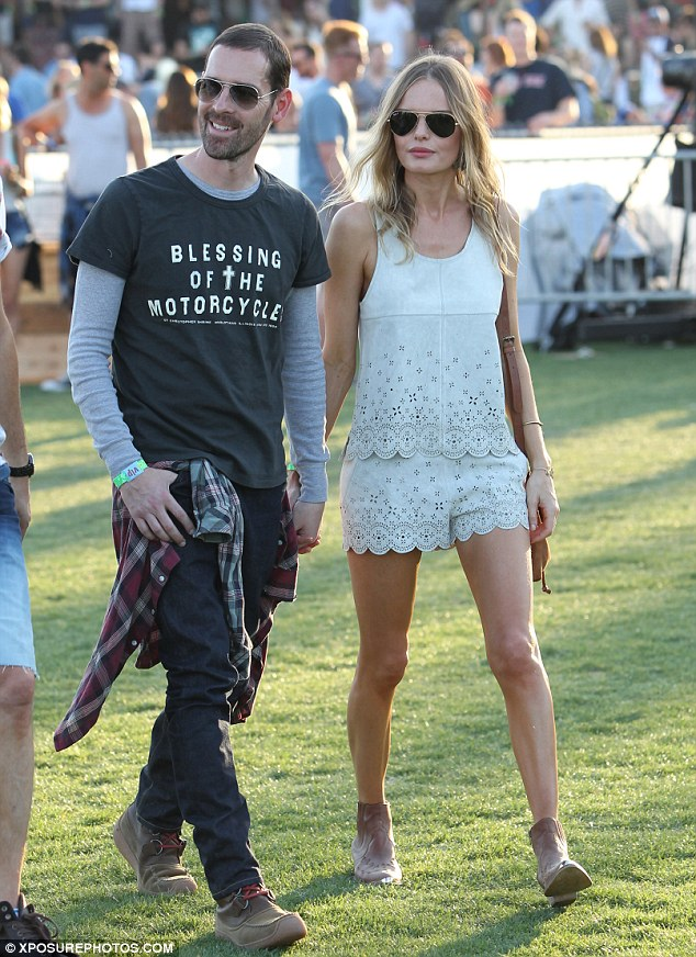 Hippie style: Kate Bosworth flaunted her slender legs in tiny embroidered shorts as she walked hand-in-hand with fiance Michael Polish at Coachella in the California desert on Frida