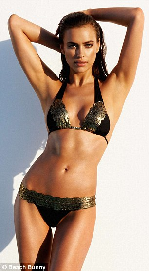 Smouldering: The Russian model perfectly shows off the designs for 2013 swimwear range