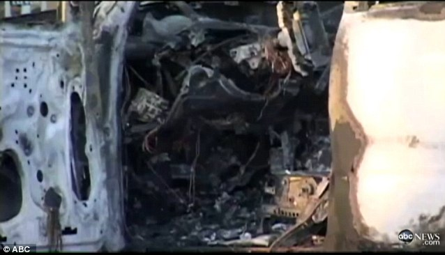 It looks as if a bomb went off inside the SUV after it was torched by a panhandler
