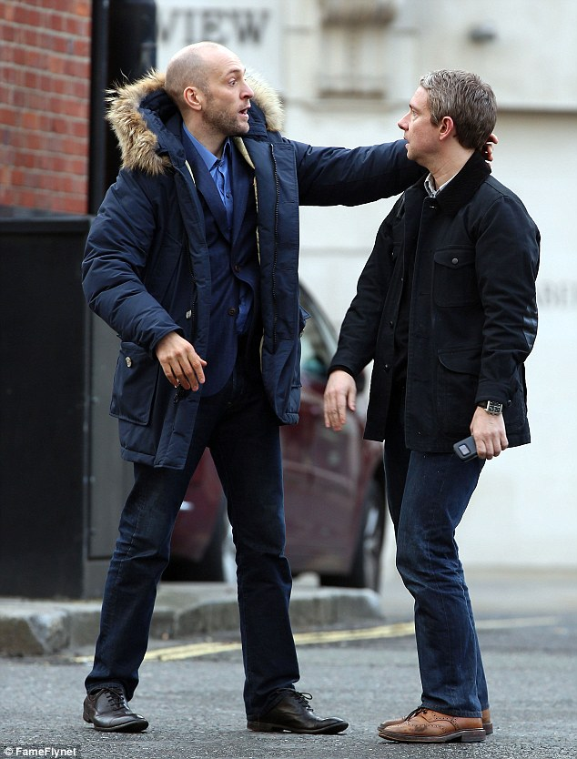 What's he up to: Derren Brown seems to hypnotise Martin Freeman's Dr. Watson character as filming for the new series of Sherlock continues