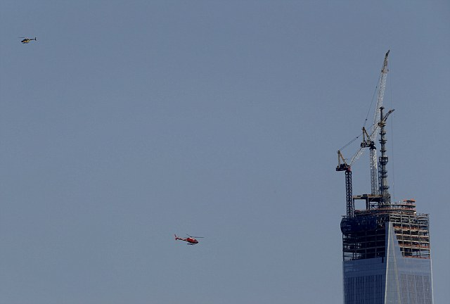 Helicopters fly near the construction site of One World Trade Center. Officials in New York increased security after the two bombs at the Boston Marathon were detonated, fearing a copycat attack