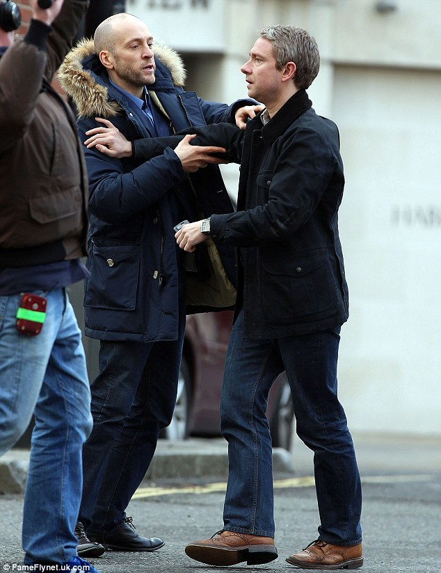 On set: Derren Brown (L) and Martin Freeman on set of the new Sherlock in London