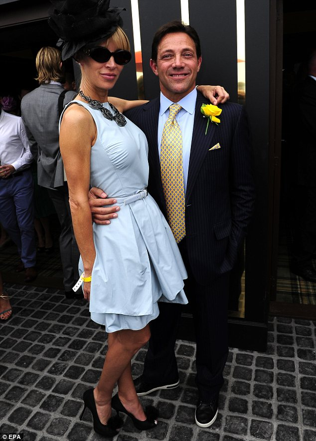 High life: Belfort poses with his fiancée at the Melbourne Cup in Australia in November last year