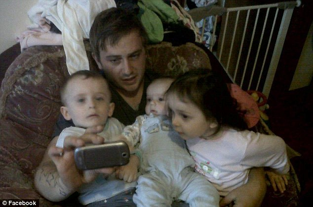 Family: Father Craig McLellan pictured with his children (left to right) Addy Kyden and Levina. The three were found dead in their mother's falt this morning