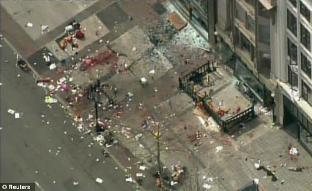 Aftermath: An NBC still shows the debris and blood strewn area after the area was cleared on Monday