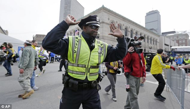 Control: Every single one of Boston's 2,100 police officers has been called to work following the explosions
