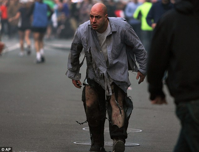 Lucky escape: A man hit by the blast walks away from the scene with shredded pants