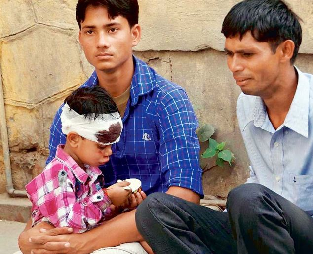 Devastating: The couple's son, pictured with relatives, sustained head injuries