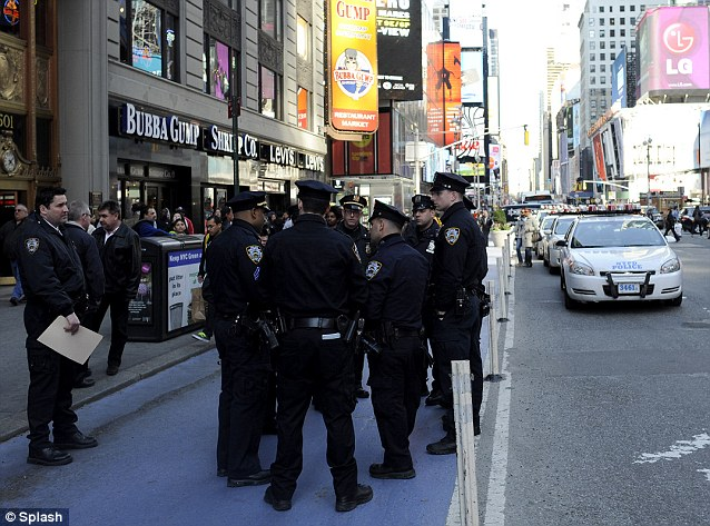 Dozens of uniformed NYPD officers setup post in the center of New York City's Times Square following news of the Boston Marathon explosions.