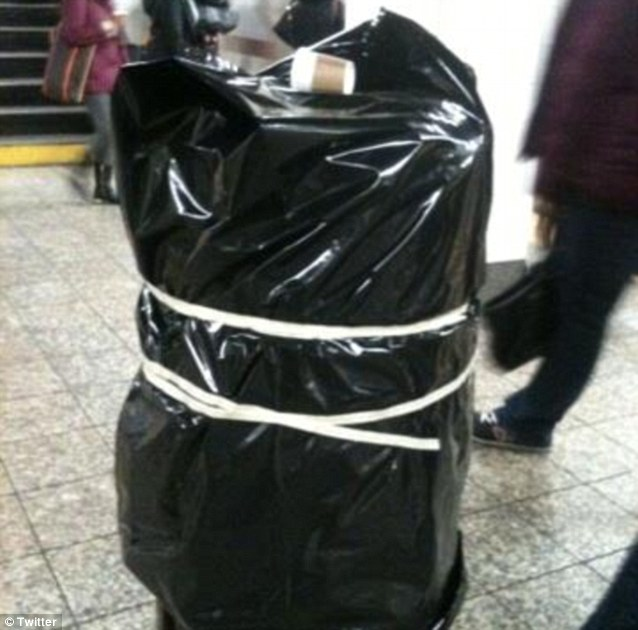 A Twitter user posted this picture from a New York City subway platform that shows a garbage can taped up, preventing an explosive device from being tossed inside and left