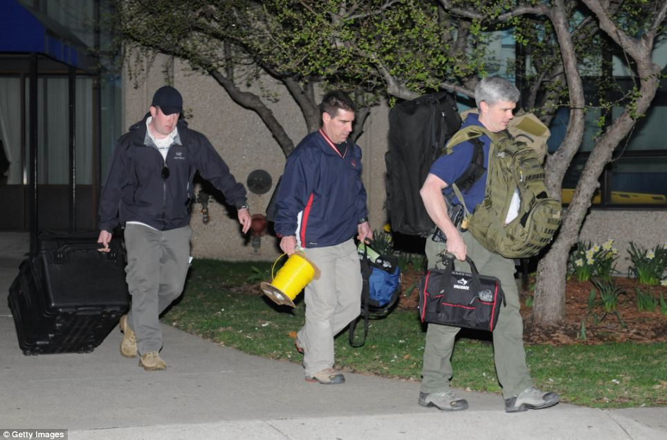 Hunt: Police and federal officials exit an apartment complex at 364 Ocean Avenue with a possible connection to the earlier explosions that occurred during the Boston Marathon on Monday