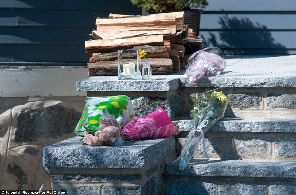 Sympathy: Flowers and gifts are left by loved ones outside of the Richard family home in Dorchester, Massachusetts on Tuesday morning