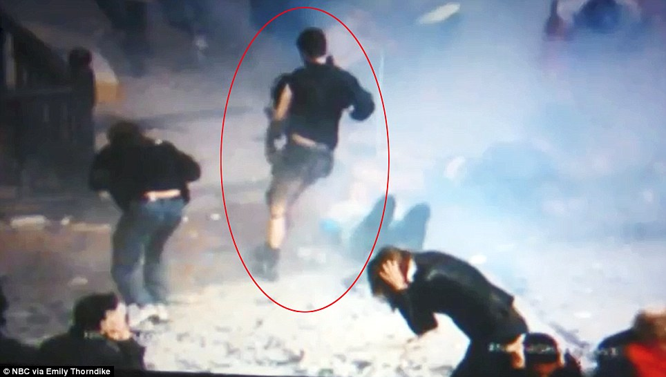 Could this be the bombing suspect? The man runs away as everyone around him instinctively falls to the ground or covers their ears