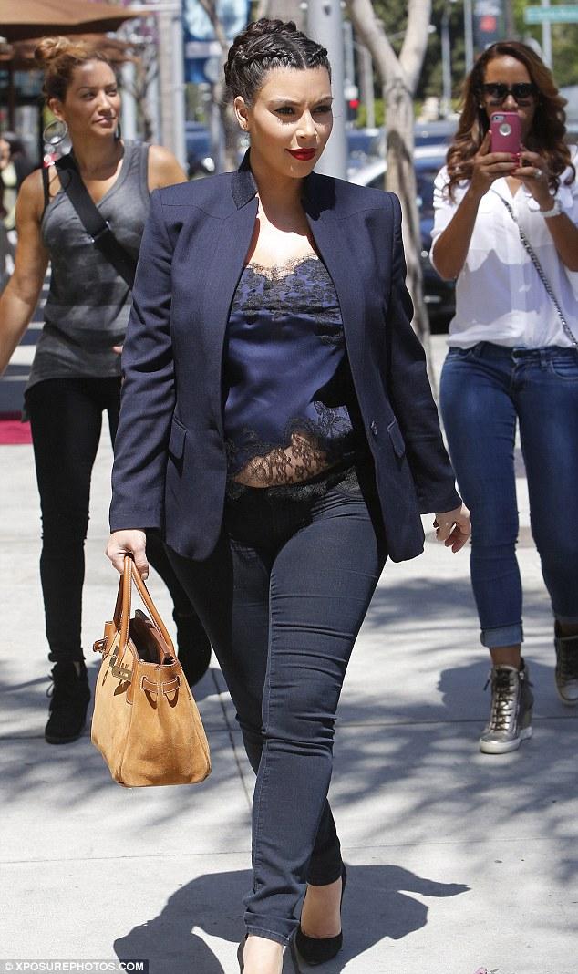 Kourtney Kardashian flashes bare midriff in crop top and