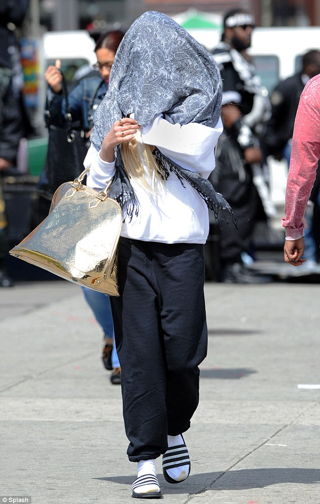 What are you looking at? Amanda Bynes came up with a new way to avoid media criticism as she covered her face with a scarf on Saturday in Manhattan