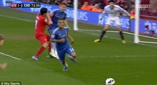 Bite: Millions of fans around the world watched on TV as controversial Liverpool striker Luis Suarez, 26, sank his teeth into the arm of Chelsea defender Branislav Ivanovic during the clubs' 2-2 draw