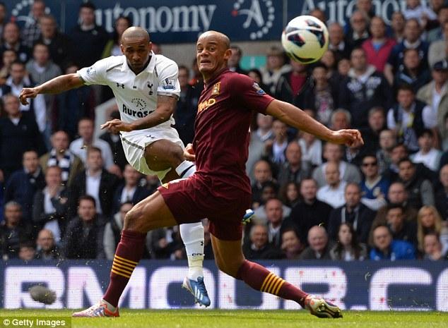 Cracker: Jermain Defoe curls home Tottenham's second goal, as Vincent Kompany looks on helpless