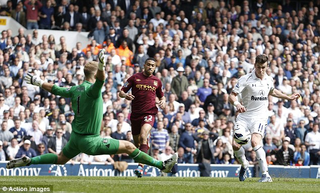 That'll do it: Gareth Bale dinks the ball over Joe Hart to make it 3-1 and complete the comeback