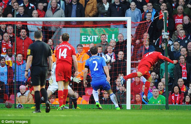 At the death: Luis Suarez headed in a late equaliser to rescue a point for Liverpool against Chelsea