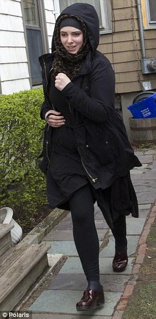 American wife of marathon bomber Tamerlan Tsarnaev, Katherine Russell, leaving the house where he lived on Norfolk street in Cambridge