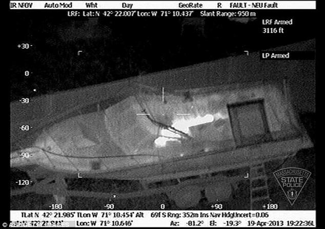 Hidden: Authorities located bombing suspect Dzhokhar Tsarnaev using infrared light, which lit up his body hiding under a tarp