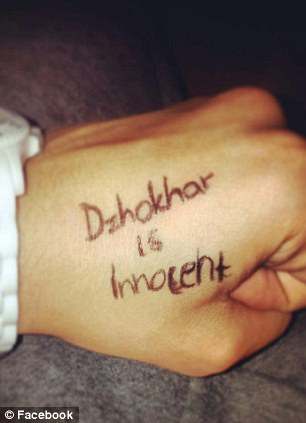 A young believer marks her hand with 'Dzhokhar is innocent'