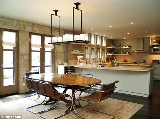 Kitchen table: Six can be easily seated for everyday meals in this family home for millionaires