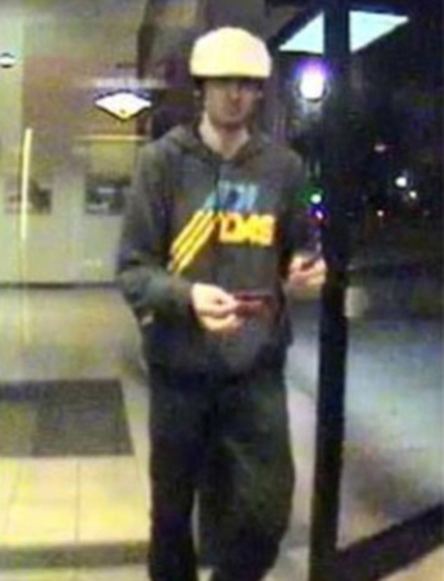 Chilling: Boston Marathon bombing suspect Dzhokhar Tsarnaev, now wearing a beige cap, captured on camera using an ATM card hours before a police shoot-out where his brother and accomplice died