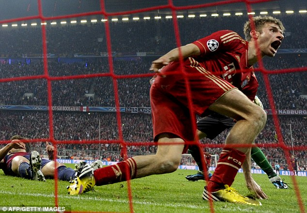 Wheeling away: Muller celebrates scoring his second and Bayern's fourth to set Barca Mission Impossible