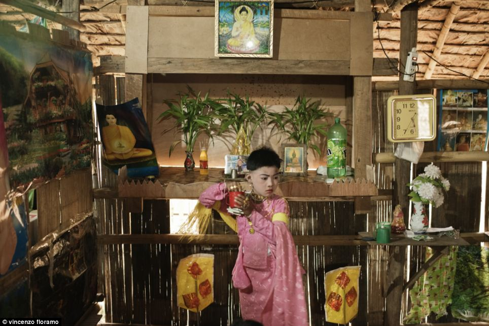 The The Win performs the guest invitation ceremony on a small Buddha Shrine