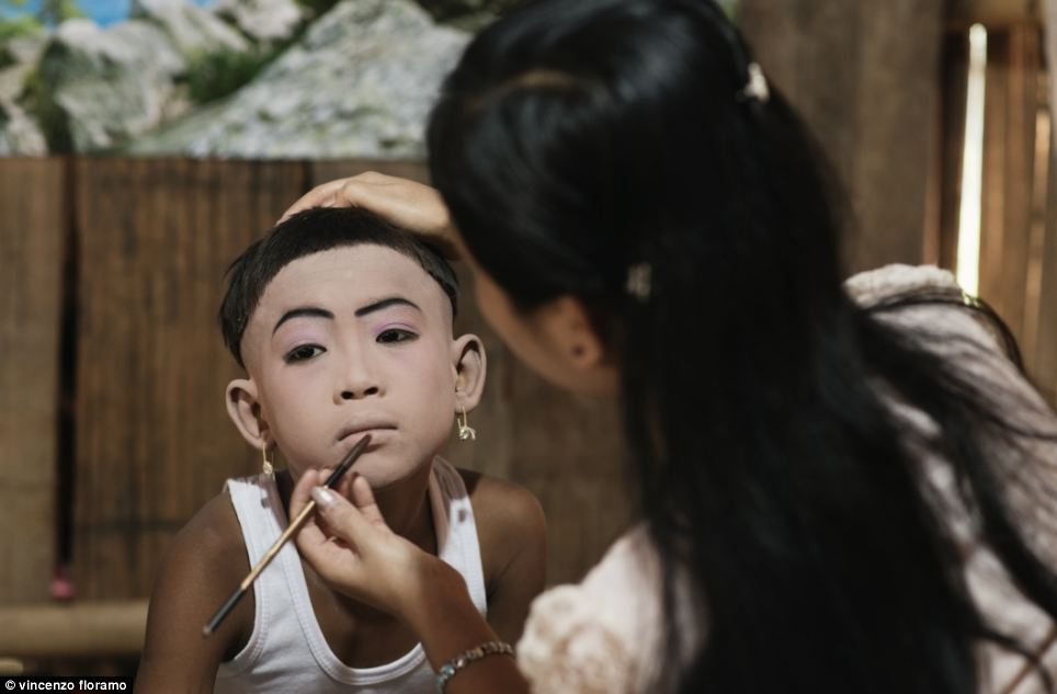 On the morning of the shaving ceremony one of the boys gets carefully made up by his mother