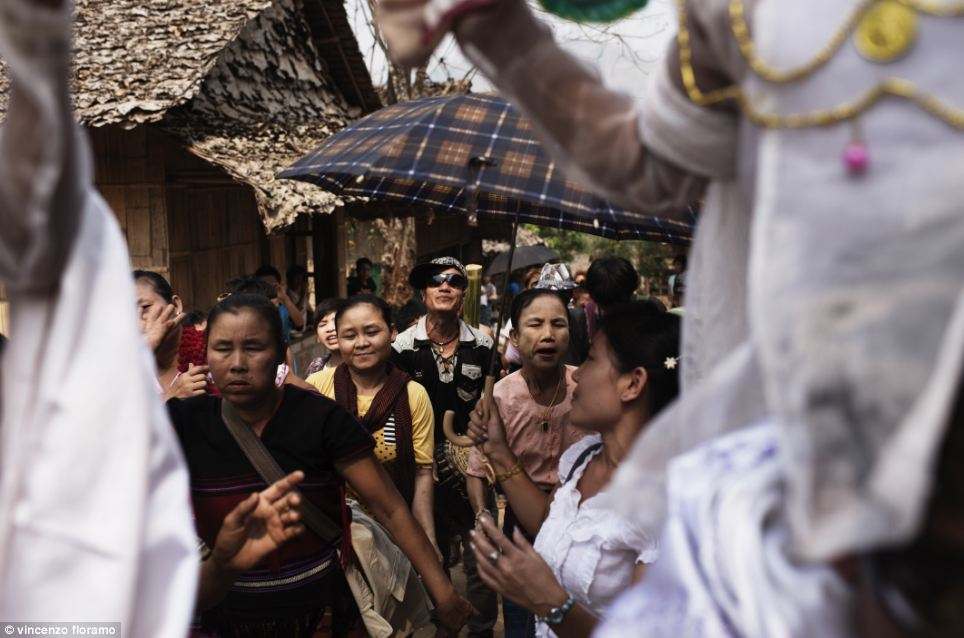 The families of the young boys follow the procession to the Buddhist Monastery of Mae La refugee camp