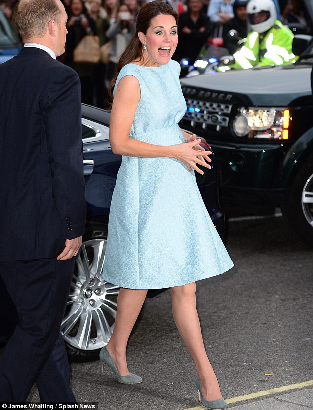 Is the baby kicking? The Duchess pulled an unusual face as she stepped out of the car