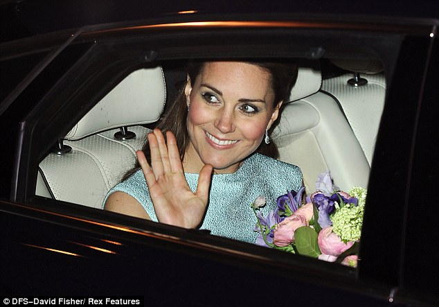 Bye: Kate smiled and waved as she was driven home