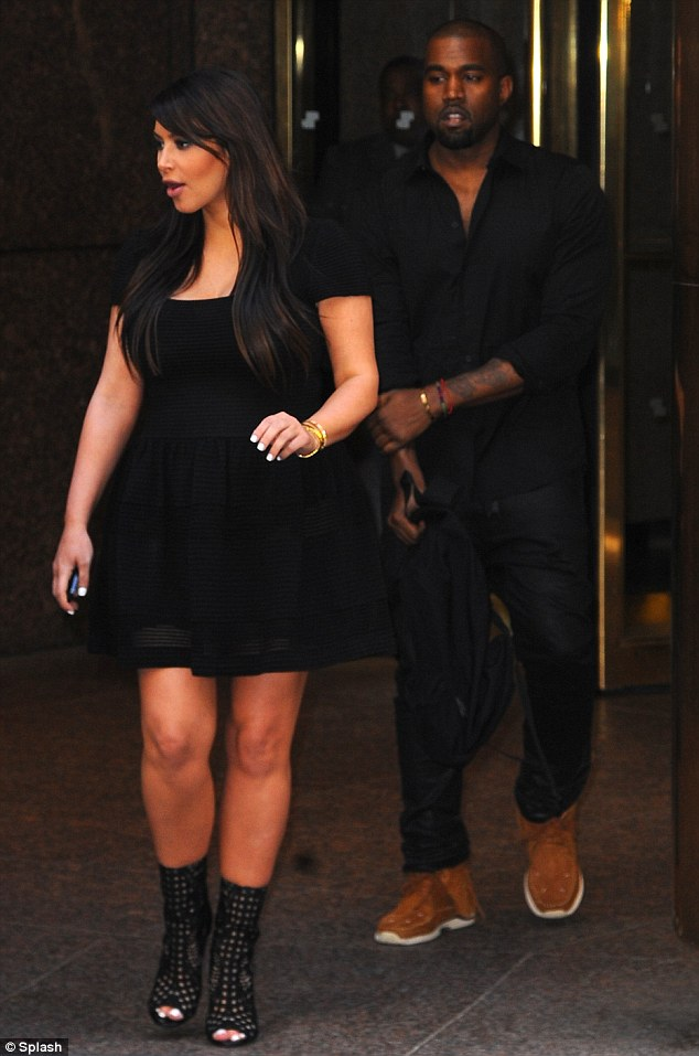 Surprised? Kim appears taken aback as she is greeted by fans and press