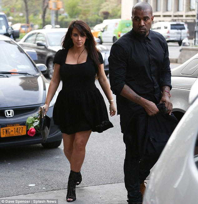 A gift from Kanye? It is unknown whether the pretty bloom was given to her by a fan or her beau, but she happily held it in her hand as they crossed the road