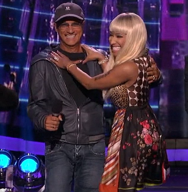 Celebrity crush: Saucy Nicki Minaj ran onto the stage and pretended to throttle cheeky Jimmy