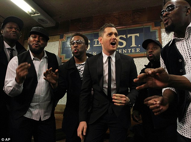Going a capella: The 37-year-old was joined by a capella group Naturally 7 to sing the Jackson 5 classic 'Who's Lovin' You' in the New York City subway Thursday morning