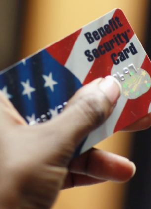 A Federal food stamps card is used to purchase food in Fort Lauderdale, Florida