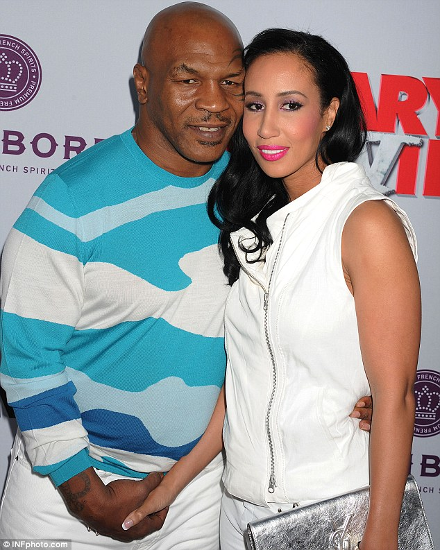Current love: The former heavyweight boxer with his third wife Lakiha Spicer at the Scary Movie 5 LA premiere earlier this month