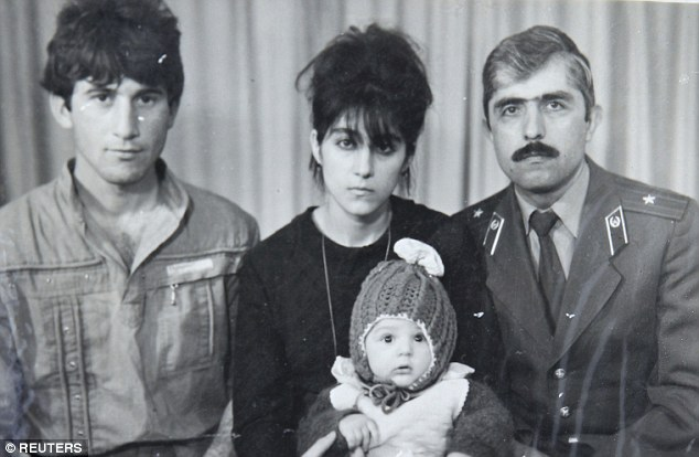 Family: Investigators want to know about the mother's influence over hers sons (Zubeidat, center in an undated photo holding a baby Tamerlan, with the boy's father Anzor (left) and uncle Muhamad Suleimanov (right)