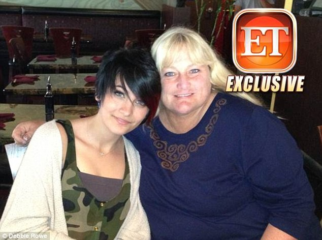 Mother-daughter reunion: The first picture of Paris Jackson reuniting with her mother Debbie Rowe on her 15th birthday at Ahi Sushi in Studio City, California on April 3
