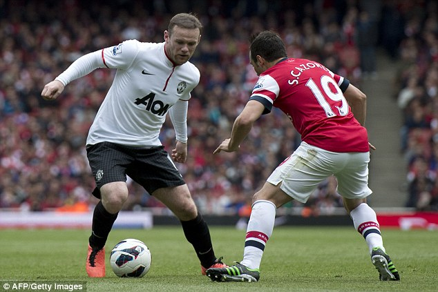 Dropping the shoulder: Wayne Rooney tries to lose Santi Cazorla in the centre of the park