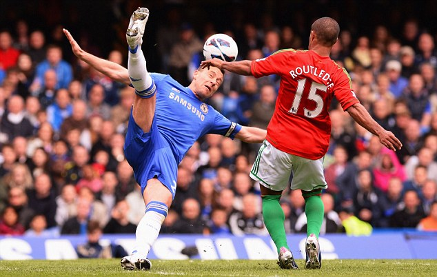 Battle: Wayne Routledge vies for possession with John Terry