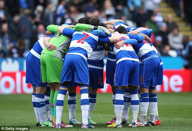 Huddling up: Reading players try to psyche themselves up before the match