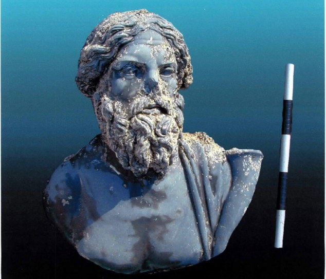Historical: A bust found in the mud along the remains of Heraclion which sunk under the Mediterranean sea over 1,000 years ago