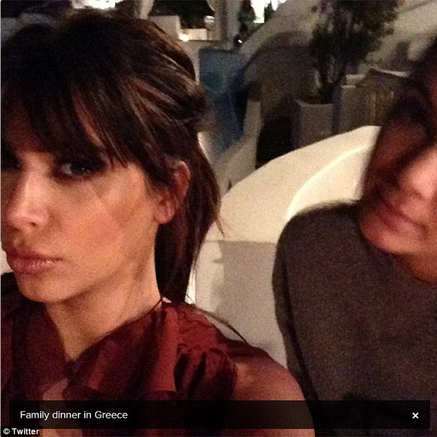 Pout: Kim tweeted a picture of herself posing for the camera with half-sister Kendall Jenner half-smiling next to her