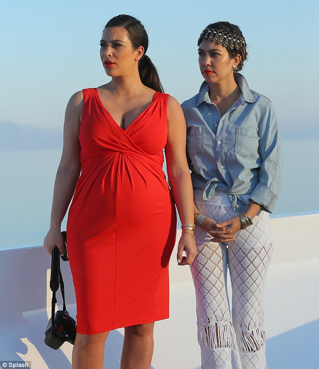 Greek goddesses: Kim and Kourtney looked gorgeous in their stylish outfits and red lipstick as they stared into the distance